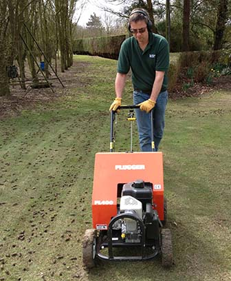 Tim operating the hollow tine aeration machine