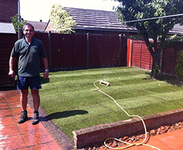 Fresh green turf laid on a small lawn