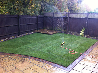 fresh green turf laid with patio